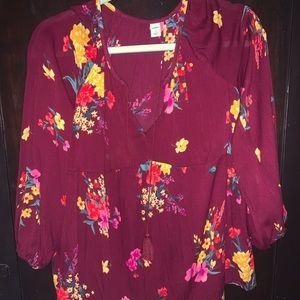 Floral shirt.